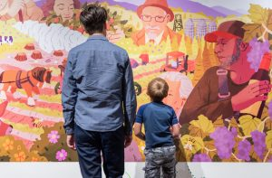 Father and Son viewing Mural
