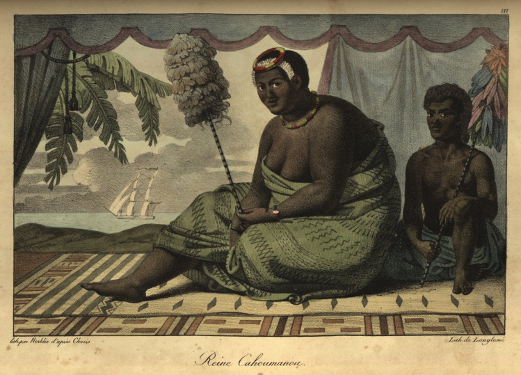 A color lithograph of a man and woman sitting side by side on a rug. In the background there are curtains that create the effect of a stage. They are open, revealing a backdrop of an ocean scene with a ship, a palm tree, and clouds over the water. The woman—Ka'ahumanu—is wearing a green patterned cloak that covers her body up to her chest, a headdress, a necklace, and a bracelet. The man beside her—her attendant—is wearing a head covering, and a plain blue wrap that covers his waist,