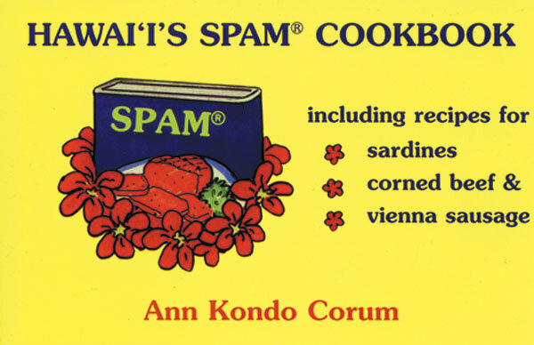 "Graphic of a yellow cookbook cover with blue text that reads: ""HAWAI'I'S SPAM COOKBOOK."" There is a drawing of a SPAM can surrounded by red flowers. To the right of the can there is a list titled ""including recipes for"" that lists ""sardines,"" ""corned beef &,"" ""vienna sausage."" Each list item appears on its own line with a ""bullet point"" in the shape of a red flower like the ones surrounding the can of SPAM. At the bottom, the author's name, ""Ann Kondo Corum"" is printed in red."