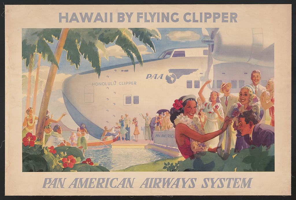 """A color lithograph with bold light blue text across the top that reads: """"HAWAII BY FLYING CLIPPER."""" At the bottom, there is italicized light blue text that reads """"PAN AMERICAN AIRWAYS SYSTEM.""""  In the foreground of the image at center there is a stereotypical portrayal of a smiling Native Hawaiian woman wearing a red and reaching out towards a smiling  White man in a suit and tie. Directly behind the White man is a White woman viewing the interaction and smiling. In the background, there is a massive, docked clipper that reads, """"HONOLULU CLIPPER"""" and has the Pan American Airways logo and abbreviation on it. Around the clipper there are many White people wearing light-colored suits and colorful dresses. The landscape is stereotypically tropical, framed by palm trees and large red flowers. Near the palm trees on the left there is a small group of people wearing stereotypical Hawaiian dress. There are four women wearing long green skirts, short shirts, and flowers. A single man is sitting on the ground in a white t-shirt."""