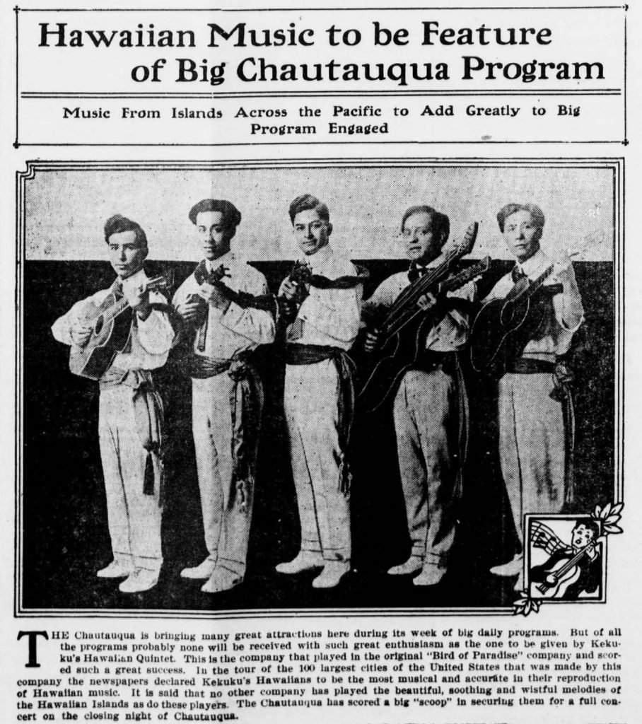 """A newspaper article with the headline, """"Hawaiian Music to be Feature of Big Chautauqua Program: Music From Islands Across the Pacific to Add Greatly to Program Engaged."""" There is a large black and white photograph of a band of five male musicians standing in a line. They are wearing matching outfits: light-colored collared shirts, a tie, light-colored pants, and a ribbon-like belt that hangs below the knee on the left side. Each of them is holding an acoustic stringed instrument."""